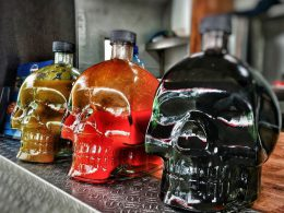 Three sauce bottles in the shape of skulls