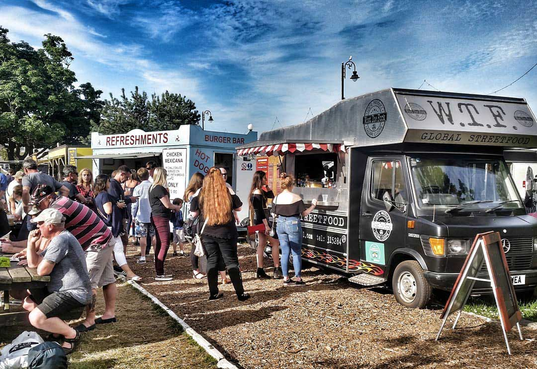 What The Fork Street food truck with a burger bar in background and people in the Villa Marina Gardens