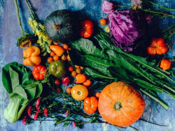 colourful display of pumpkins, various tomatoes, vegetables, flowers and salad leaves