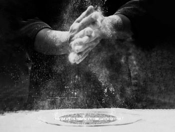Floury hands with flour dust over what the fork logo